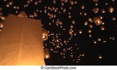 flying lantern launching - Thousands of floating lanterns...
