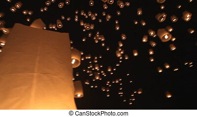 Thousands of floating lanterns launching for Loy krathong buddhist festival in Mae Jo university near Chiang Mai, Thailand.