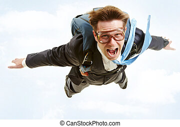 Flying man - Conceptual image of young businessman flying ...