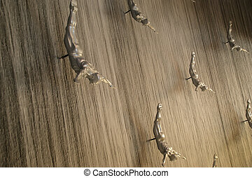 Flying men at the waterfall in the Dubai Mall. Dubai, United...