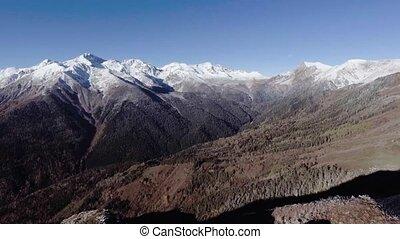 Flying near winter mountain range valley Aerial 4k video....