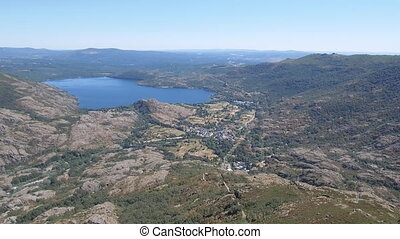Flying off Sanabria Lake, dolly zoom - Aerial dolly zoom of...