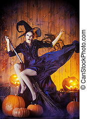 flying on a broomstick - Beautiful fairy witch with her...