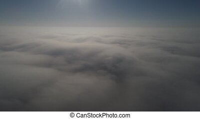 Flying on a drone above the clouds. Aerial view, 4k video -...
