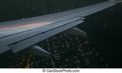 Flying on a plane, dark wing view - Plane flight window view...