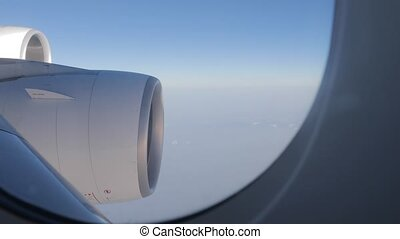 Flying on a plane, jet engines - Big jet engines of a four ...