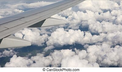 Flying on a plane - View from plane window during approach,...