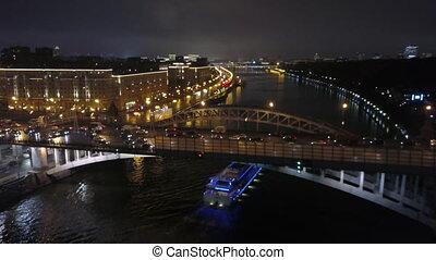 Flying over a night city bridge