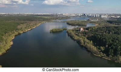 Flying over a river and forest near the city of Minsk.The reservoir space invaders.Belarus.Europe.