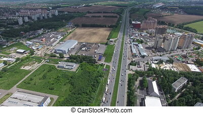 Flying over a suburban area with its highway, residential districts and square fields