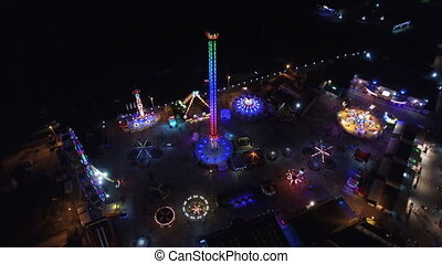 Flying over the amusement park at night