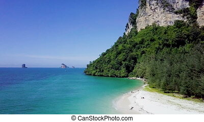 Flying over beautiful beach at island in Krabi Thailand -...