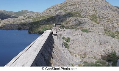 flying over broken dam - flying zoom over broken dam wall