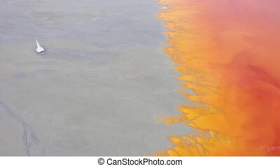 Flying over chemical waste, water polluted with contaminated...
