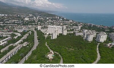 Flying over coastal city in Crimea - Aerial shot of city on...