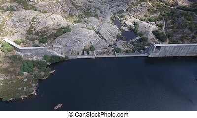 Flying over collapsed dam, top view