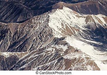 flying over colorado rocky mountains