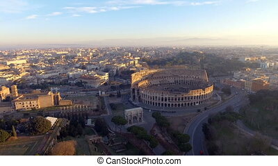 Flying over Colosseum, Rome, Italy. Aerial view of the Roman...