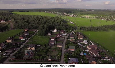 Aerial view of vast green rural areas with villages, fields and forests. Living in the countryside, Russia