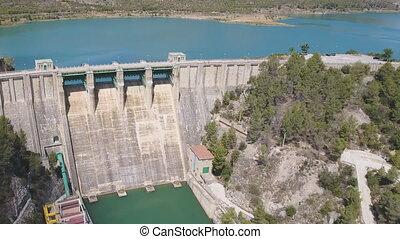 Flying over dam, ascending camera - Ascending over dam with...