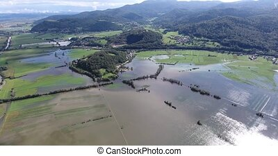 Flying over flooded fields.
