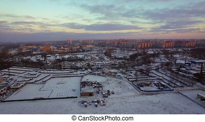 Flying over industrial district with houses in distance. St. Petersburg, Russia