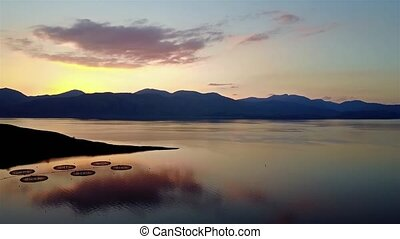 Flying over Loch Linnhe during sunset by Appin, Scotland,...