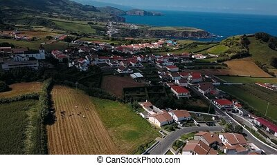 Flying over Maia city coasts on San Miguel island, Azores...