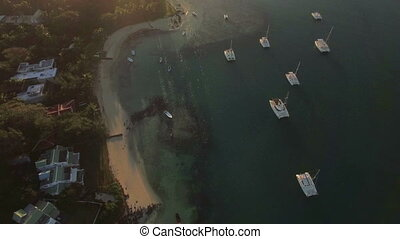 Flying over Mauritius coast at sunset