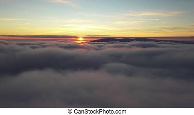 Flying over morning clouds with the late sun.