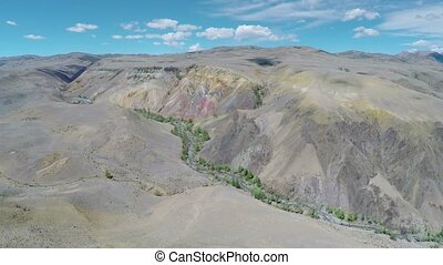 flying over multicolored mountains - Altai, Russia