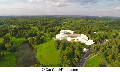 Flying over park and palace in Pavlovsk, St. Petersburg,...