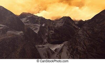 Flying Over peaks in Clouds - Flying Over peaks in the...