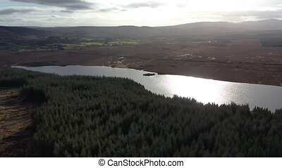 Flying over peatbog next to the town Glenties in County Donegal - Ireland.