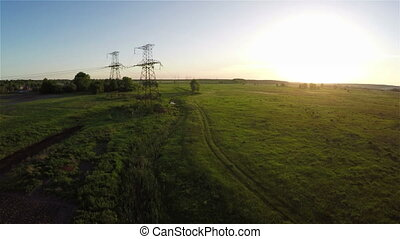 Flying over power line at sunset, aerial survey