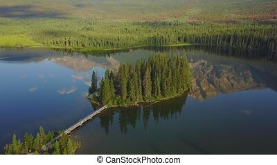 Flying over Pyramid Lake, Alberta, Canada - Flying over...