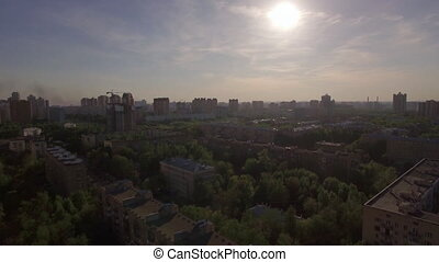 Flying over residential district with houses in Moscow,...