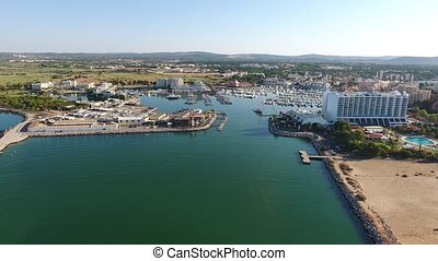 Flying over seaport with yachts, the entrance to the Marina. Vilamoura.