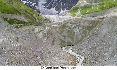 Flying over Shkhara Glacier in svaneti Rocks. Snow peak in...