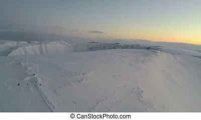 Flying over snow covered Khibinsky Mountains