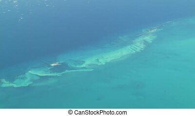 Aerial footage of isolated islands in The Bahamas. Actual high altitude footage.