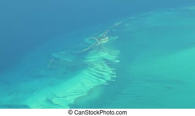 Flying over The Bahamas. Beautiful ocean colors. Actual aerial footage.