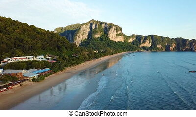 Flying over the beautiful beach at Krabi in Thailand. Green...