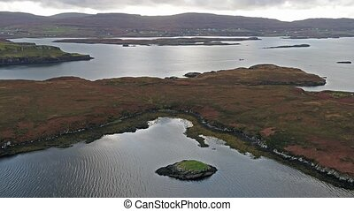 Flying over the beautiful west coast close to Dunvegan Castle - Scotland