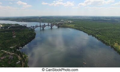 Flying over the bridge on the river