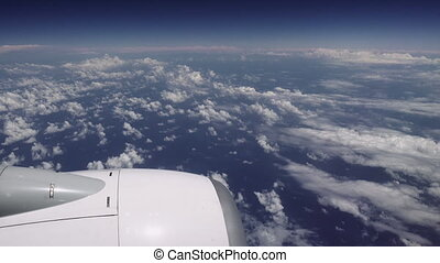Flying over the clouds. View from plane aircraft.