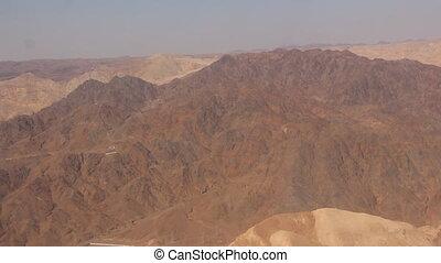 flying over the desert mountains