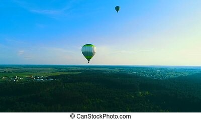 Flying over the hot air balloon. Hot air balloon in the sky...