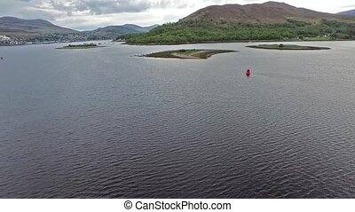 Flying over the Loch Linnhetowards the famous locks in Fort...