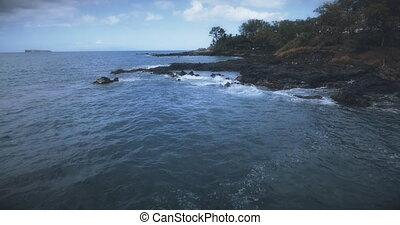 Flying over the Maui Coastline. 4K UHD establishing shot.